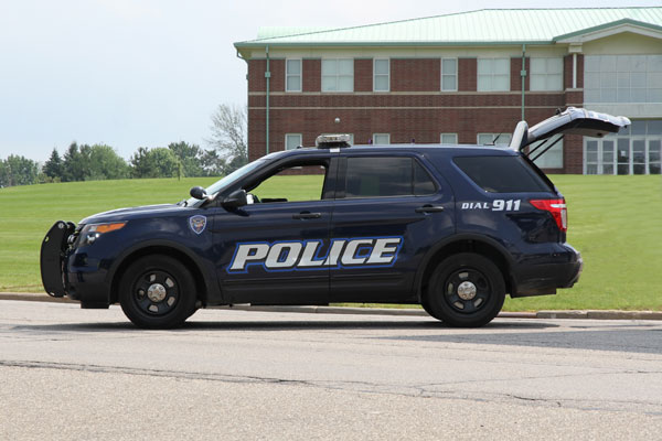 Image of police SUV with back hatch open representing location of ARAM Mobile, radiation detection systems that can be deployed in law enforcement vehicles for PRND.